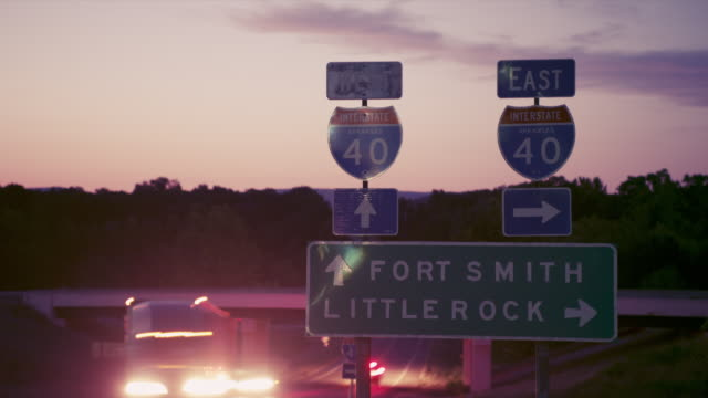time lapse night time traffic on interstate 40, with fort smith and little rock highway sign - arkansas stock videos & royalty-free footage
