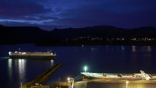 time lapse night to dawn cargo ship arriving at port of lyttelton through lyttelton harbour / lyttelton, new zealand - hill stock videos & royalty-free footage
