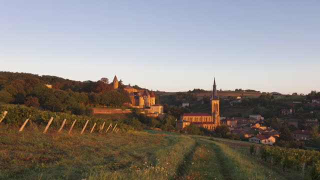 Time Lapse Night to day Tracking shot of village of Jarnioux in Beaujolais