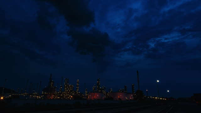 time lapse: night to day view refinery in morning. - oil rig supply ship stock videos and b-roll footage
