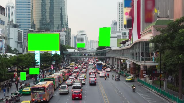 time lapse night traffic jam on rama i road in rush hour after worker at evening time central world front area with ad green screen, bangkok, thailand. - long stock videos & royalty-free footage