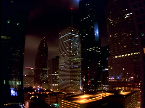 vidéos et rushes de time lapse night with clouds to dawn of downtown houston skyscrapers - cinématographie