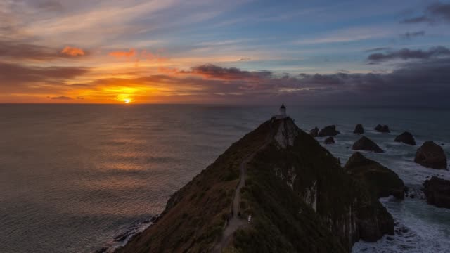 4k time lapse : nugget point lighthouse in the morning, new zealand. - lighthouse stock videos & royalty-free footage