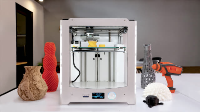time lapse of a 3d printer printing a yellow container with a cap - 3d printing stock videos and b-roll footage