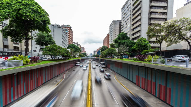 CARACAS - CIRCA 2013: Time lapse of a Avenita Libertador a busy street in Caracas with cars, people and bus