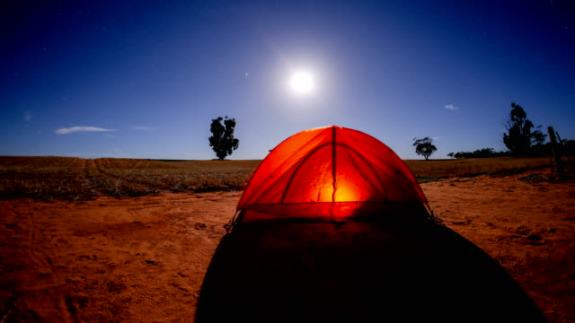 time lapse of a camping tent at night - mountain range stock videos & royalty-free footage