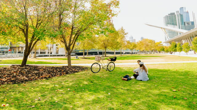 4K Time lapse of a couple eating together and working in a park, in Melbourne, during autumn Victoria, Australia