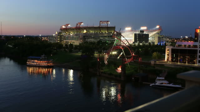 Time lapse of a football stadium from a pedestrian bridge during a night game in Nashville, Tennessee.