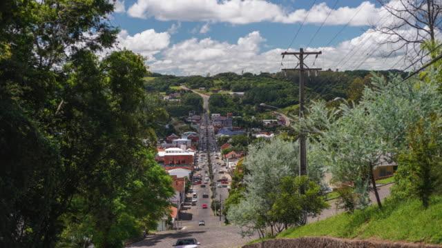 time lapse of a lively avenue in a small town in southern brazil. - stato di rio grande do sul video stock e b–roll