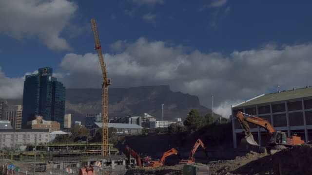 TIme lapse of a major contruction site in Cape Town South Africa with Table Mountain in the background