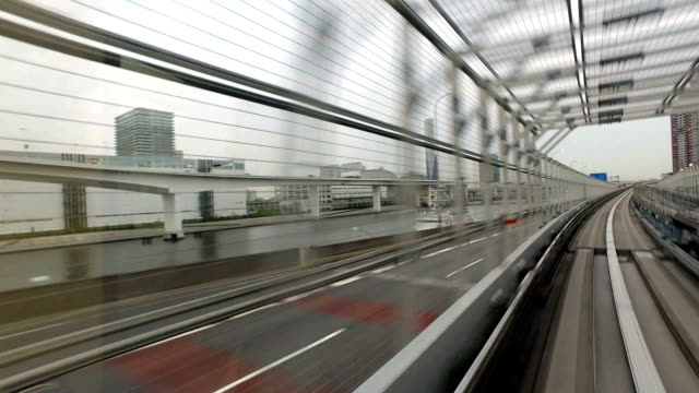 time lapse of a monorail pov in tokyo, japan - bahngleis stock-videos und b-roll-filmmaterial