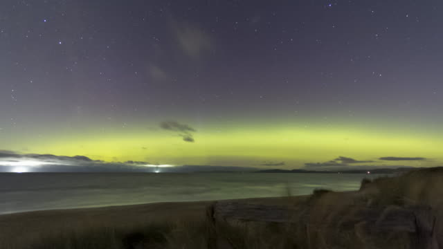 time lapse of a moonlit aurora australis or southern lights over the ocean - aurora australis stock videos & royalty-free footage