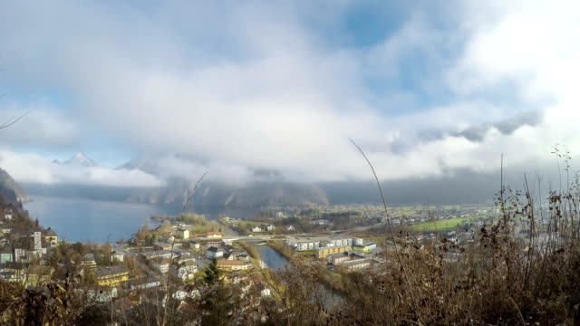 time lapse of a small town on a lake surrounded by mountains - salzkammergut stock videos and b-roll footage