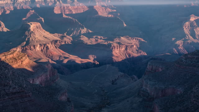time lapse of a sunrise casting low light over the incredible grand canyon arizona - national park stock videos & royalty-free footage