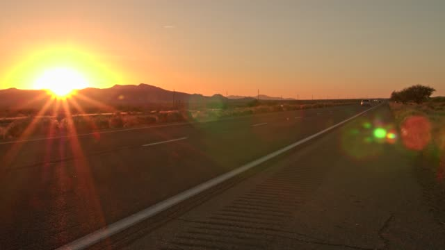 time lapse of a sunset over north 93 highway near kingman, arizona, united states of america, north america - kingman arizona stock videos & royalty-free footage