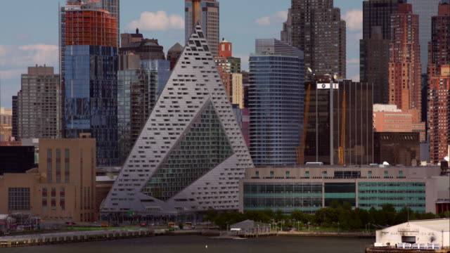 Time lapse of abstract via57 West building among New York City skyline in Hell's Kitchen