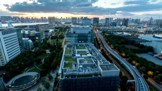 4K time lapse of aerial skyline of Tokyo cityscape of Odaiba area, Tokyo bay waterfront at twilight, Japan.