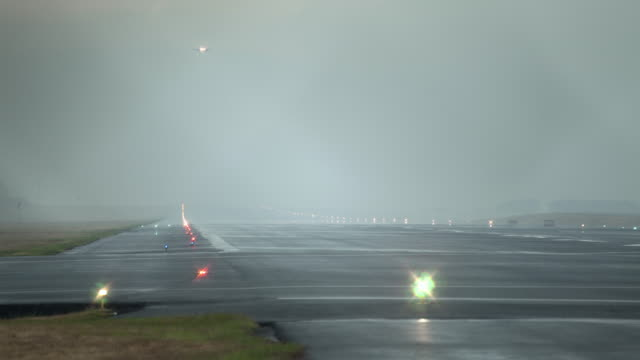 time lapse of airplanes landing on runway - san jose costa rica stock videos & royalty-free footage