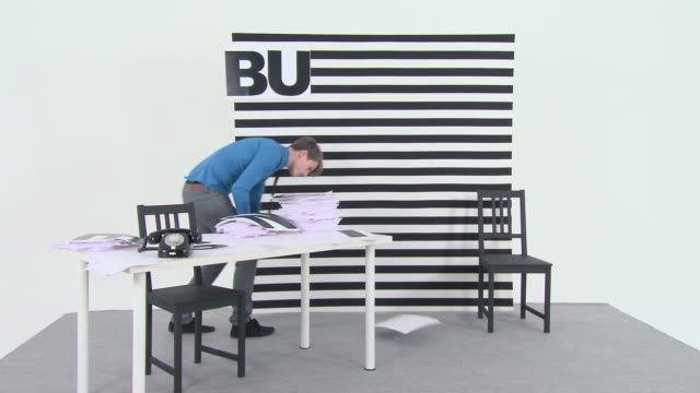 Time lapse of an office worker spelling the word business on a board