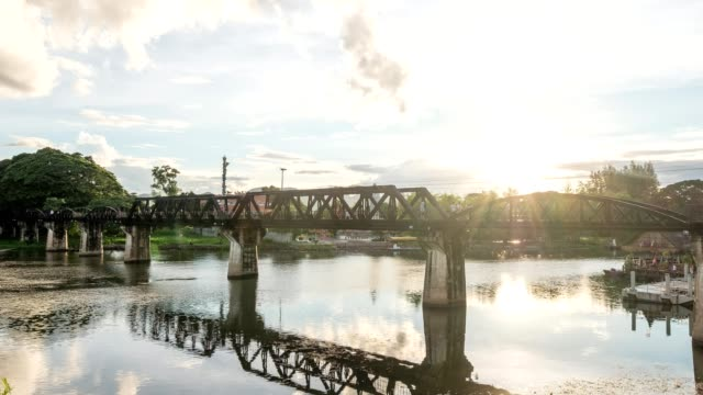 time lapse of ancient railway bridge with train running over in river kwai - tramway stock videos & royalty-free footage