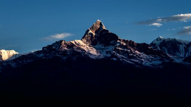 time lapse of annapurna sunset, nepal - annapurna range stock videos and b-roll footage