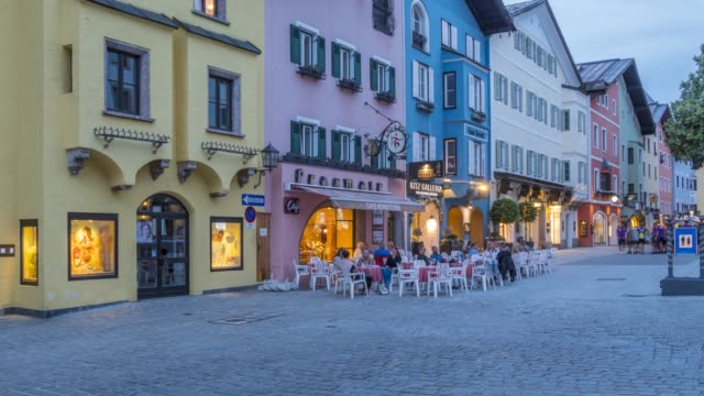 time lapse of architecture and cafes on vorderstadt at dusk, kitzbuhel, austrian tyrol region, austria, europe - traditionally austrian stock videos & royalty-free footage