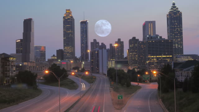 Time Lapse of Atlanta City Building Skyline, Traffic and Rising Full Moon