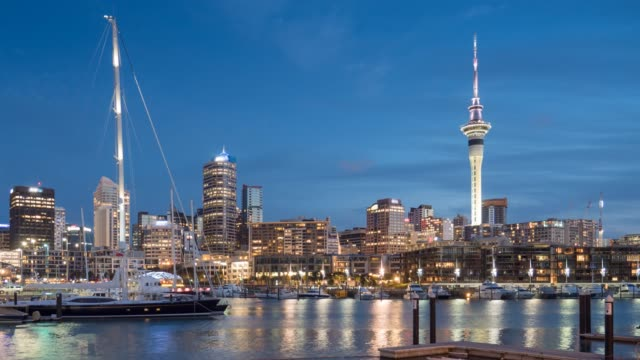time lapse of auckland city day to dusk time twilight shot after sunset , auckland city new zealand - new zealand stock videos & royalty-free footage