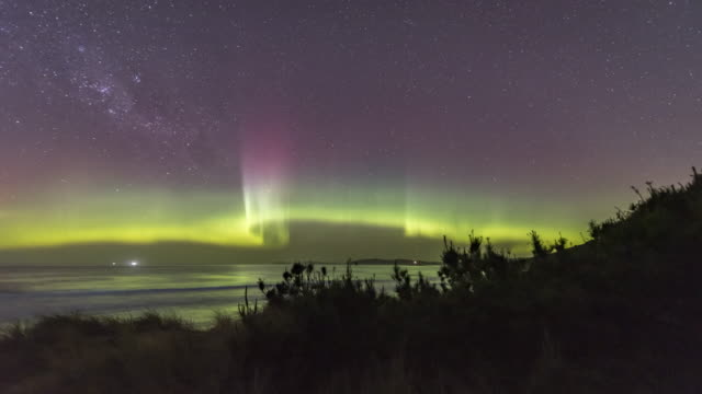 time lapse of aurora australis or southern lights, spectacular display over a beach in tasmania. - aurora australis stock videos & royalty-free footage