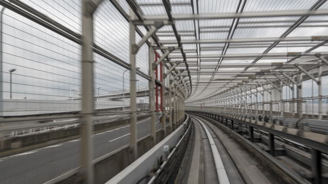 time lapse of automated monorail in japan - railway bridge stock videos & royalty-free footage