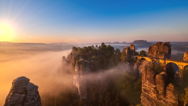 time lapse of bastei bridge, elbe sandstone mountains, elbsandsteingebirge at sunrise - dresden germany stock videos & royalty-free footage