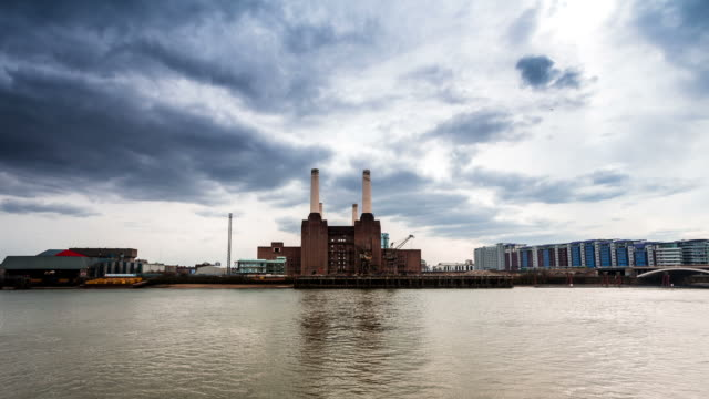 london - circa 2013: time lapse of battersea power station in a cloudy day with some sunshine - battersea stock videos & royalty-free footage