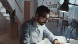 Time Lapse of Bearded Businessman Working Late at Office Desk