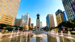 4K Time lapse of beautifully color water fountain and office building at Gwanghwamun Plaza with the statue of the Admiral Yi Sun-sin in downtown Seoul,South Korea.