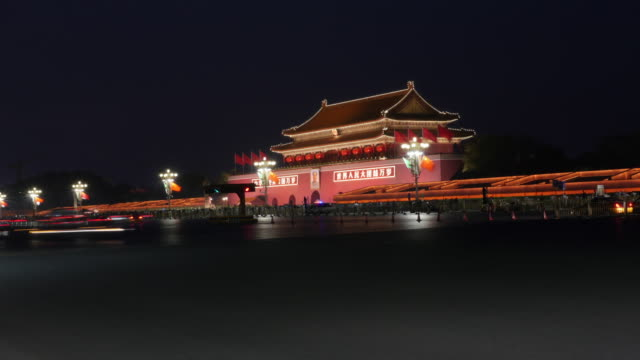time lapse of beijing tiananmen square traffic - chinese flag stock videos & royalty-free footage