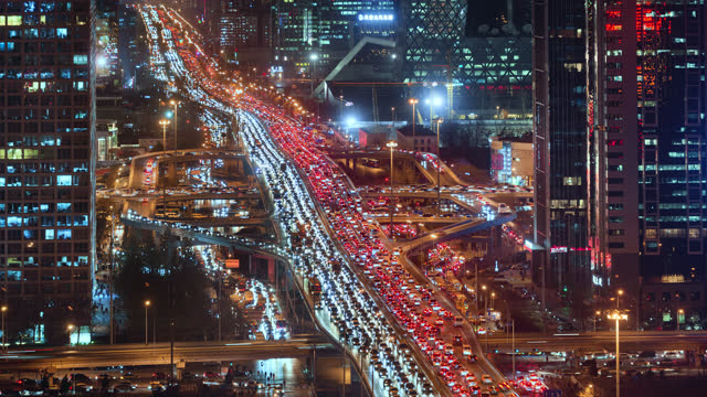 tl/ time lapse of beijing's financial district, showing guomao road intersection busy with commuters - beijing stock videos & royalty-free footage