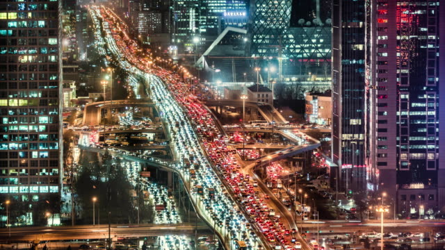 time lapse of beijing's gau mao road intersection and financial district - peking stock-videos und b-roll-filmmaterial