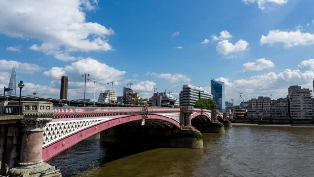 LONDON - CIRCA 2014: Time Lapse of Blackfriars Bridge the new skyscraper in Blackfriars on a sunny and cloudy day in London, England
