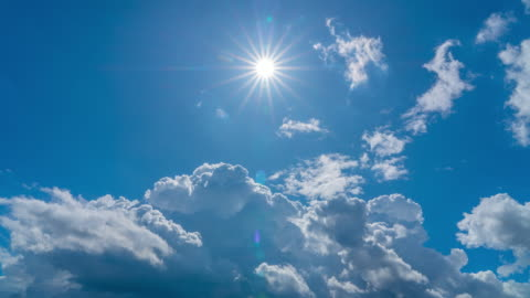 4k time lapse of blue sky moving cloudy with sharp sun rays in summer - sky only stock videos & royalty-free footage