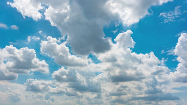 time lapse of blue sky white clouds - cumulus cloud stock videos & royalty-free footage