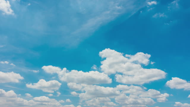 time lapse of blue sky white clouds - mckyartstudio stock videos and b-roll footage