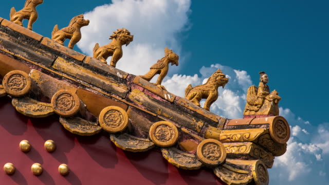 4k time lapse of blue sky with clouds and ancient buildings in the forbidden city, beijing, china - former stock videos & royalty-free footage