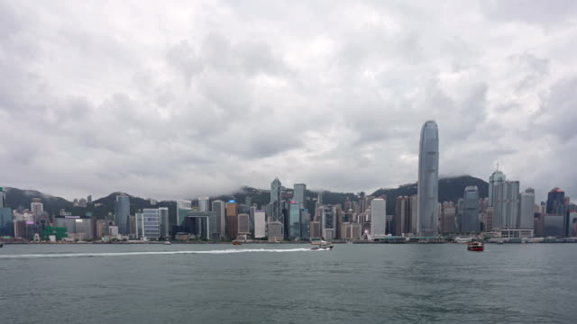 time lapse of boats and clouds over hong kong victoria harbor - hong kong island stock videos & royalty-free footage