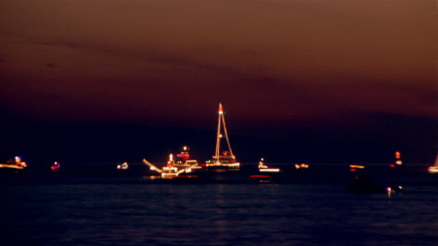 Time lapse of boats sailing past each other in Pacific / sunset to night / California