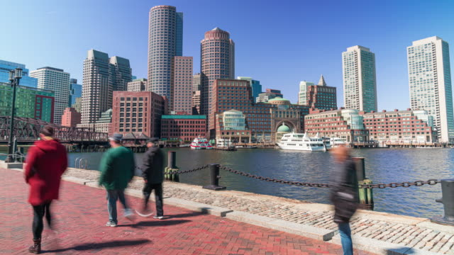 4k time lapse of boston harbor cityscape with pedestrian and tourist at fan pier park in massachusetts, united states - waterfront stock videos & royalty-free footage