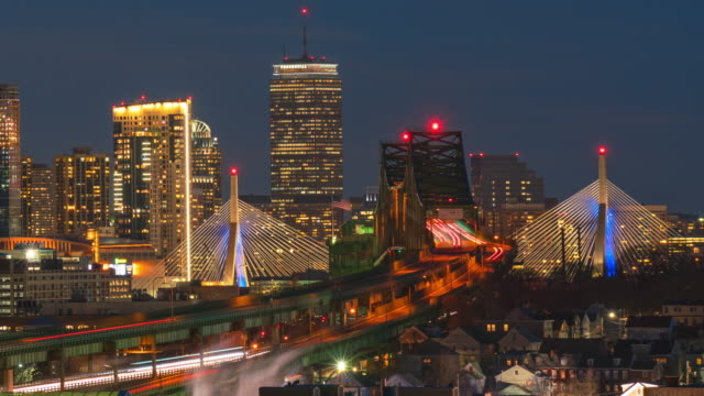 time lapse of boston skyline with bridge and express way over the cityscape day to night - back bay boston stock videos & royalty-free footage