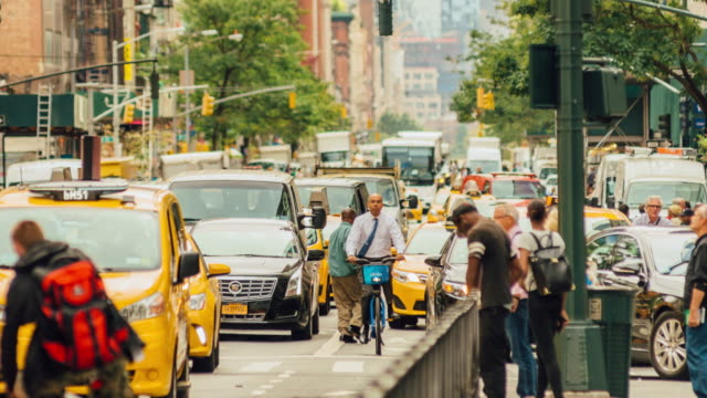 time lapse of broadway traffic in new york city - yellow taxi stock videos and b-roll footage