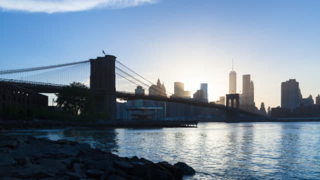 time lapse of brooklyn bridge and downtown manhattan skyline, day to night - brooklyn bridge stock videos and b-roll footage