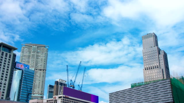 4k time lapse of buildings with blue sky - tsim sha tsui stock videos & royalty-free footage