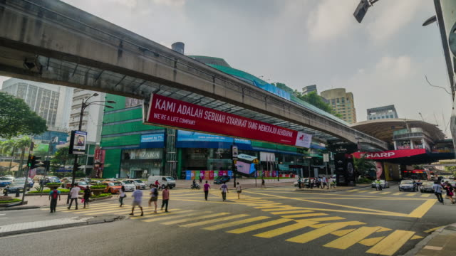 Time lapse of Bukit Bintang intersection in Kuala Lumpur, Malaysia during day and night. Bukit Bintang is a major shopping and entertainment district of KL.